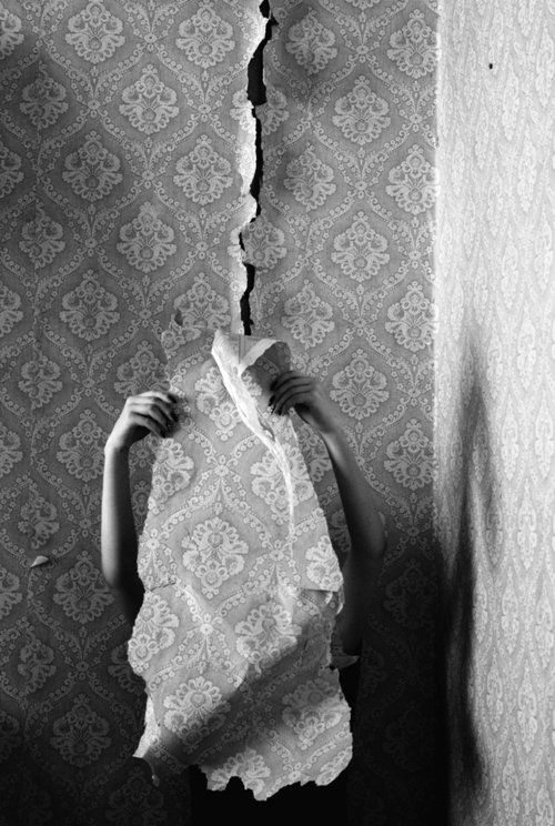 Image by Francesca Woodman - another image that belongs to her wallpaper series this time with just her arms showing. The crack running down the centre through the wallpaper creates a lot of tension.