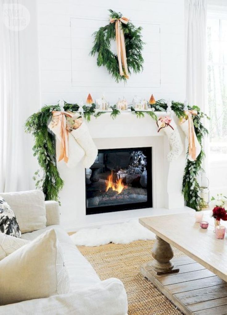 Cool 39 Simple Fireplace Christmas Decoration Ideas. More at https://trendecor.co/2017/12/08/39-simple-fireplace-christmas-decoration-ideas/