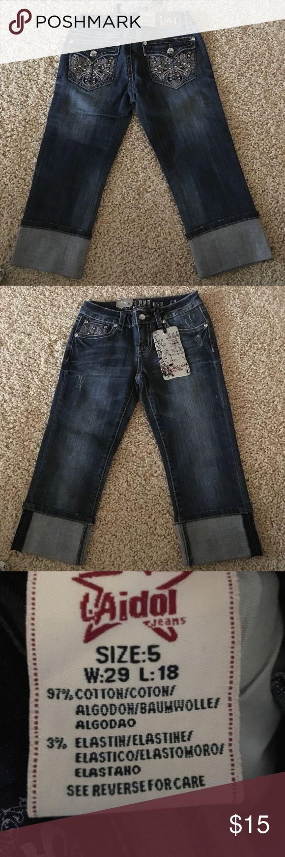 "NEW w/Tags LA IDOL Bling Capri Jeans Sz 5 Dark blu NEW w/Tags LA IDOL Capri Jeans Sz 5. Tag says 29 waist Measurement is more a 28"". 8"" Rise SUPER CUTE BLING POCKET Cuffed leg can be unrolled LA Idol Jeans"