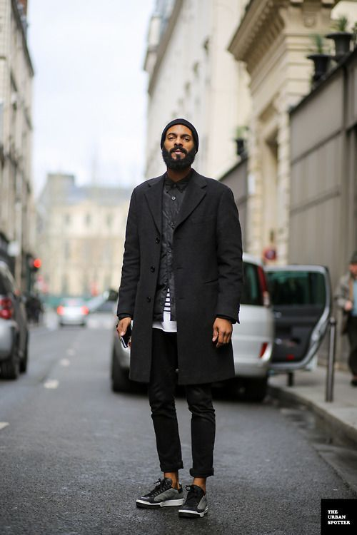Shop this look on Lookastic:  http://lookastic.com/men/looks/beanie-long-sleeve-shirt-crew-neck-t-shirt-overcoat-jeans-athletic-shoes/7466  — Black Beanie  — Black Long Sleeve Shirt  — White and Black Horizontal Striped Crew-neck T-shirt  — Black Overcoat  — Black Jeans  — Black Athletic Shoes