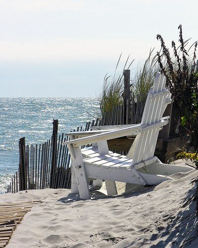 White Adirondack chair, a day at the beach by the sparkling blue