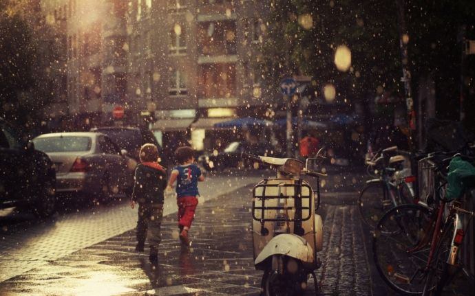 Kids playing while rainning