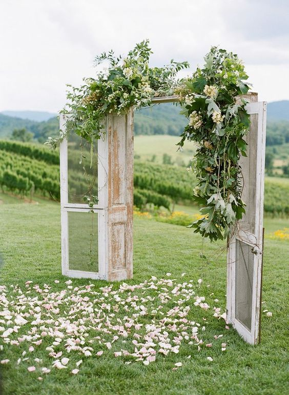 Outdoor wedding arch inspo! For a rustic themed wedding, this DIY idea is perfect. For more wedding decoration ideas, check out our board.