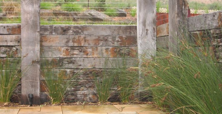 Eltham landscape design - retaining wall and Australian native grasses