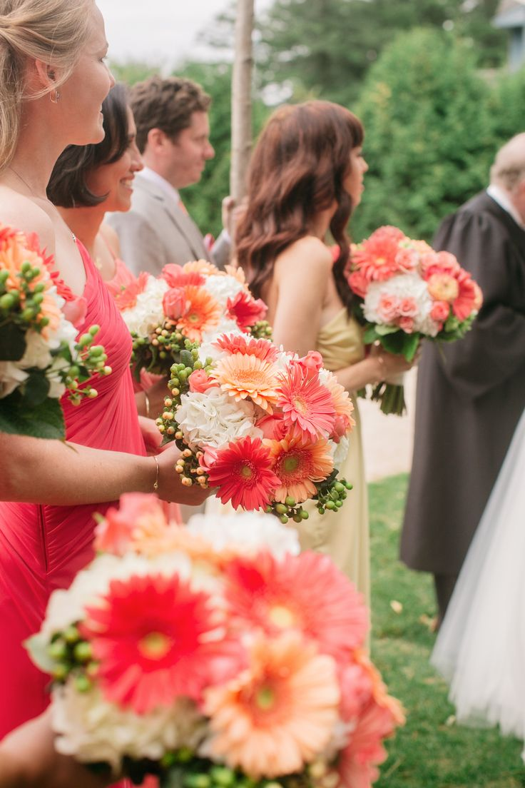 Coral Bouquets -- See the wedding on http://www.StyleMePretty.com/tri-state-weddings/2014/04/01/bright-coral-wedding-on-lake-placid/ CatherineRhodesPhotography.com