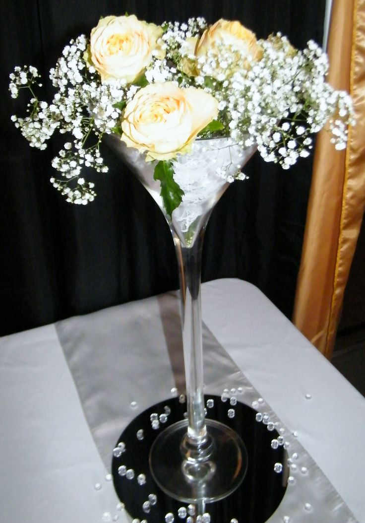 Tall Elegant Centrepiece - Narrow Martini Vase with Lace topped with babies breath and rose arrangement  - by Toowoomba White Wedding and Event Hire. Weddings, Parties, Corporate Functions {Toowoomba & Surrounding Areas}