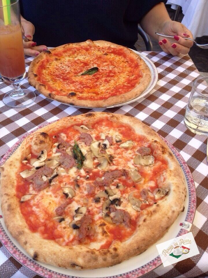 Pizza in Rome, delicious basil flavoured sauce, light thin crust. Think you couldn't eat a whole one by yourself, think again!!