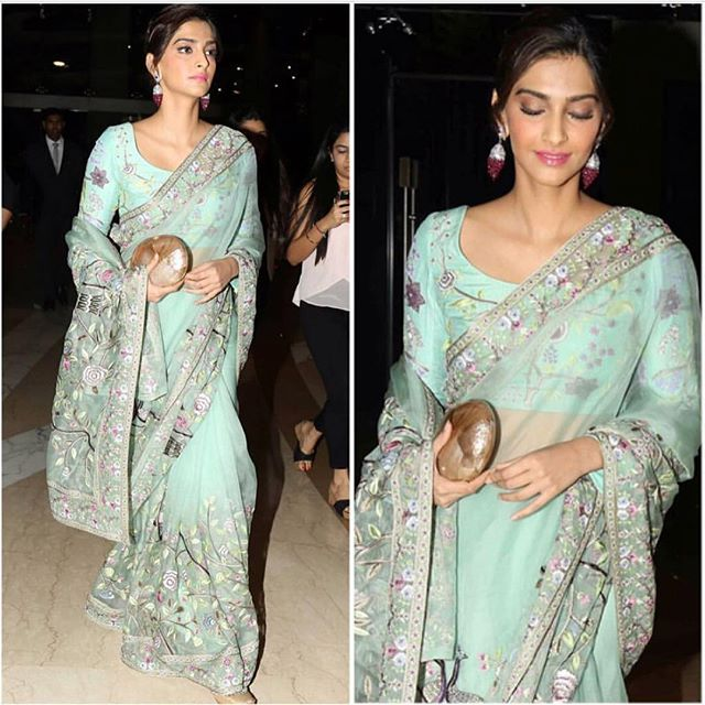 Rahul Mishra does it again with this sea green saree with hints of violet & pink :)