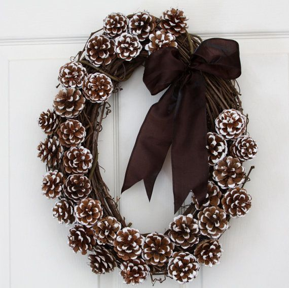 Pine cone wreath with velvet bow sold on etsy - very cute, simple to do with the right pine cones