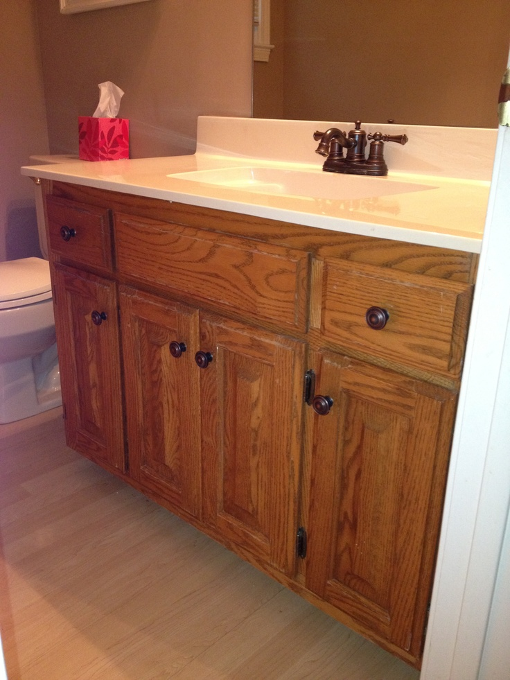 bathroom with 80 39 s honey oak cabinets before update with annie sloan