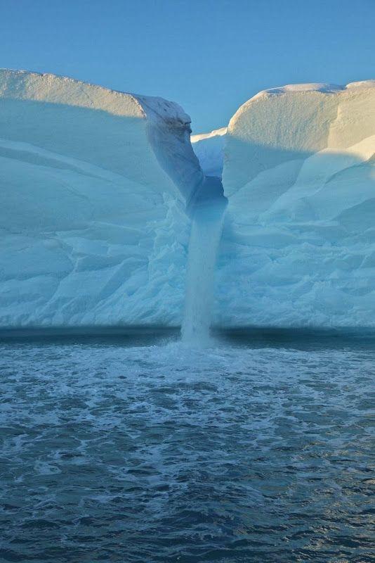 Glacier waterfall, Svalbard, Norway.