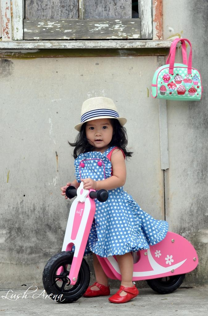 This photo was taken when Miss Madeline was just 18 mths old. To this day, I still can't get over all that hair!!    Featured in photo: RYB Audrey dress and panama hat. Sparkle T Audrey Scooter. Bobble Art handbag.