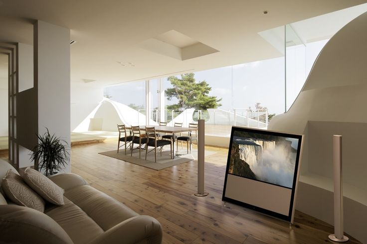 BeoVision 11 in a classy and luminous interior, matching the colour of wood.