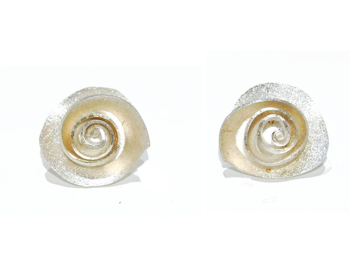 These handmade sterling silver stud earrings have been elegantly handmade into a rose flush with highly polished edges that emphasize depth and beauty.  £96 #modern #designer #jewellery #earrrings #London #NudeJewellery