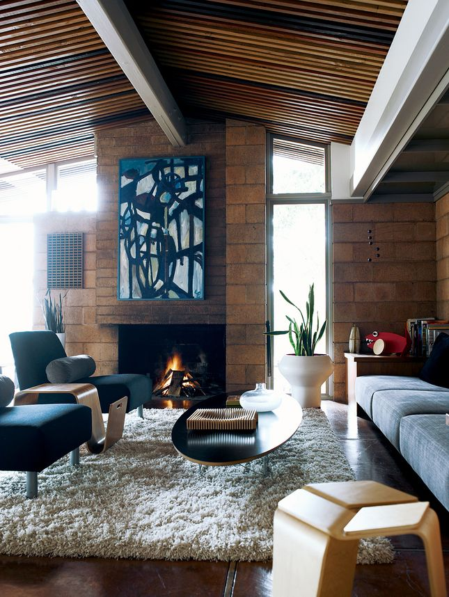 clean lined furnishings.  pottery/plant   Lovely rustic yet modern living room with very nice art choice and placement, via Dwell.