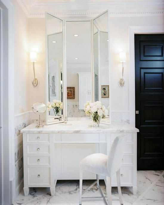 Master Bathroom Design With Visual Comfort Lighting Ruhlmann Single Sconce Flanking White Folding Mirror Over Marble Top Makeup Vanity Paired With White