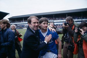 Everton manager Howard Kendall congratulates Paul Bracewell after a 2-0 victory over Queens Park Rangers at Goodison Park had clinched the First Division title, 6 May 1985.