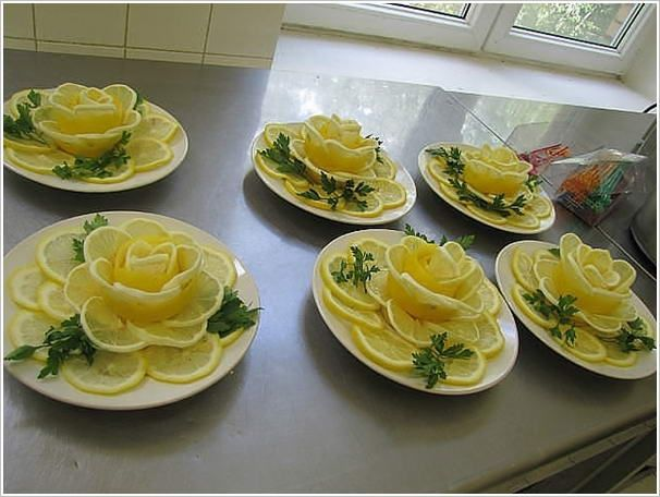 """Lemon Roses"".....Decorated food always looks tempting and that is why here some lemon flowers to garnish your food. To make the flowers shown above cut thin slices of the lemons. Then overlap a few slices over each other in a row, roll gently and place in a dish. This will be the centre of the flower. Then fill the sides around the centre with more slices to become the petals."