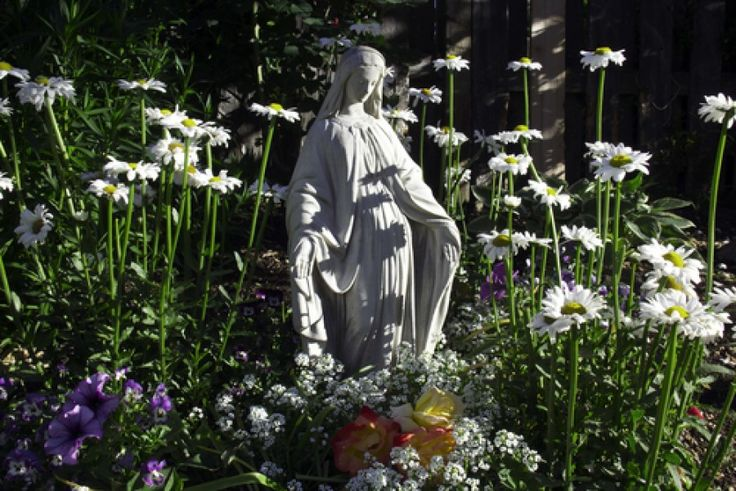 Plant a Mary Garden!  Guide to planting a garden in Mary's honor, with lots of info about the original names of flowers, which were usually religious. For example, Lady's Mantle used to be OUR Lady's Mantle.