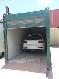Shipping Container Garage With A Roller Door Fitted.