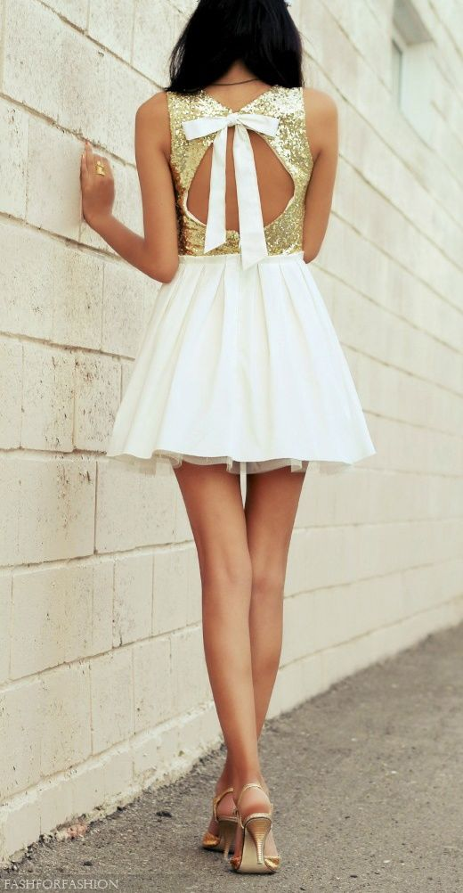 Short white dress, open back, gold sequin top, bow in back