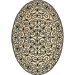 @Overstock - Iron Gate rug is hand-hooked of a pure virgin wool pile Transitional rug showcases an ivory background Floor rug displays a dark blue pattern.  Love the oval shape! Don't see that often!