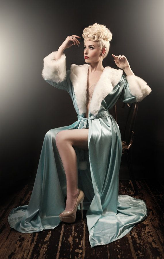 I am Hollywood Glamour I am The Classical Hollywood Peignoir Tiffany Blue A floor-length fully-lined Peignoir with luxury fur cuffs and collar. Based on actual vintage patterns from the 1940's & 1950's, this dressing gown features Hollywood style princess seaming for a slimming flattering look, creating elegant girly curves on every figure! The circumference of the Bias Cut Hem is more than 12 feet of silky satin…a luxurious grand sweeping skirt! Made in a lustrous shining crepe-back Sa...