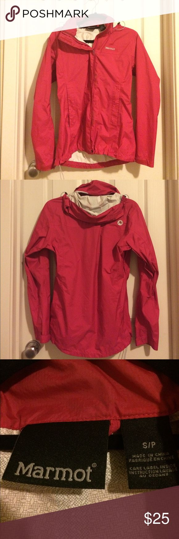 Pink Marmot women's rain jacket small This is a used women's rain jacket. It has arm pit zippers for ventilation as well as ties around the waist and hood area for tightening. Velcro shows signs of use but other in good condition. Marmot Jackets & Coats