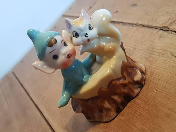 Check out this item in my Etsy shop https://www.etsy.com/au/listing/534748986/vintage-pixie-elf-and-squirrel-on-a-log