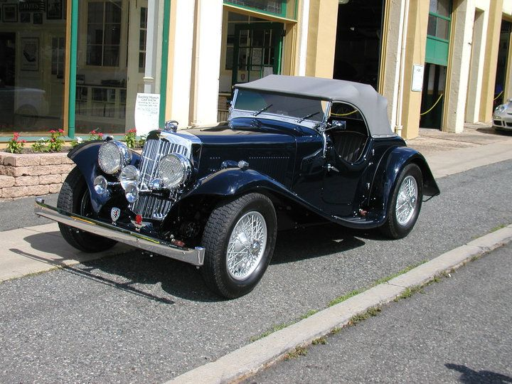 1938 Aston Martin 15/98 in midnight blue with gray interior and convertible top. Converted to hydraulic brakes and left hand drive. Beautiful Abbey coachwork!  SOLD