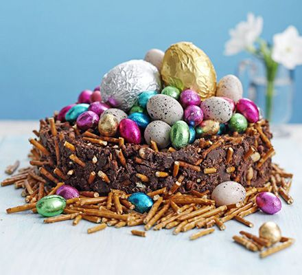 Frances Quinn's fridge cake makes a great novelty centrepiece. Make the 'nest' from pretzels, peanuts and raisins, and fill with chocolate eggs.