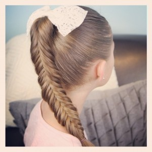 I absolutely love any type of braid! Especially fishtails. This has a different twist on it! Love it! Tutorial on cutegirlhairstyles.com!