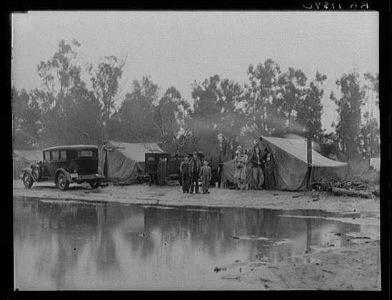 Migrant pea pickers camp in the rain. California, February, 1936. Photographer: Dorothea Lange.