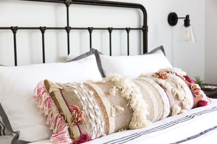 Mix it up by adding a colorful, bohemian pillow onto classic bedding!