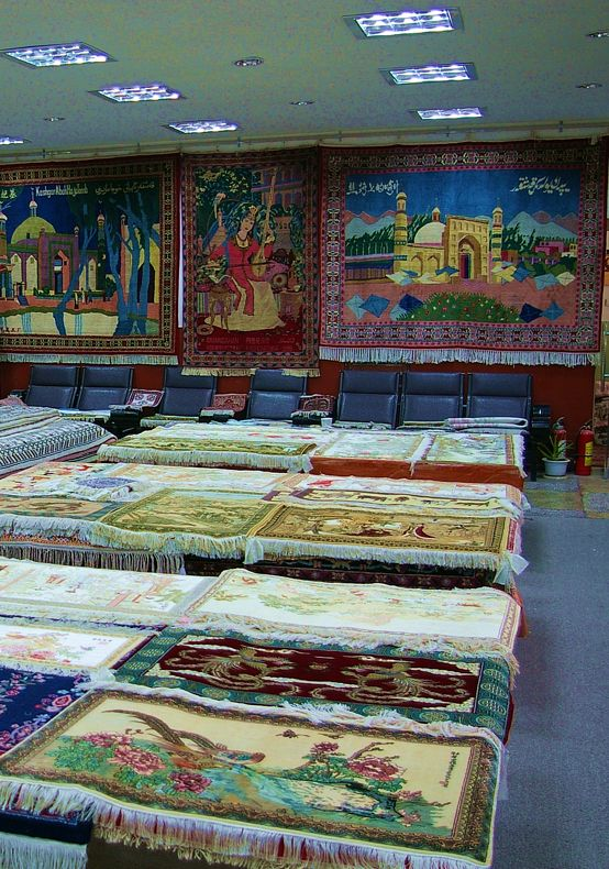 A dazzling selection of beautiful silk carpets with intricate designs inside a showroom in Kashgar.