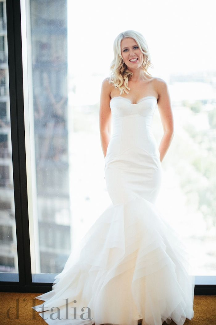 A d'Italia bride looking stunning in her custom gown featuring bespoke corsetry and beautiful silk.  Visit: www.ditalia.com.au  #melbournecouture #melbourneweddings #ditalia #bridalgown