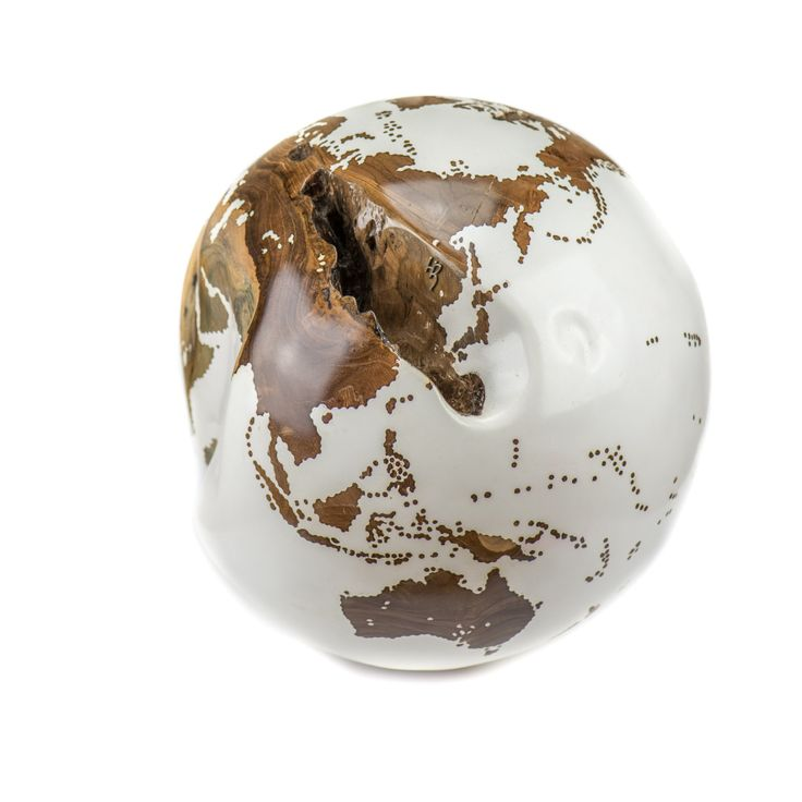 Teak globe painted with 90 layers of acrylic resin #woodenglobe #design #homewares  http://digitaledition.lighthome.com.au/#folio=5