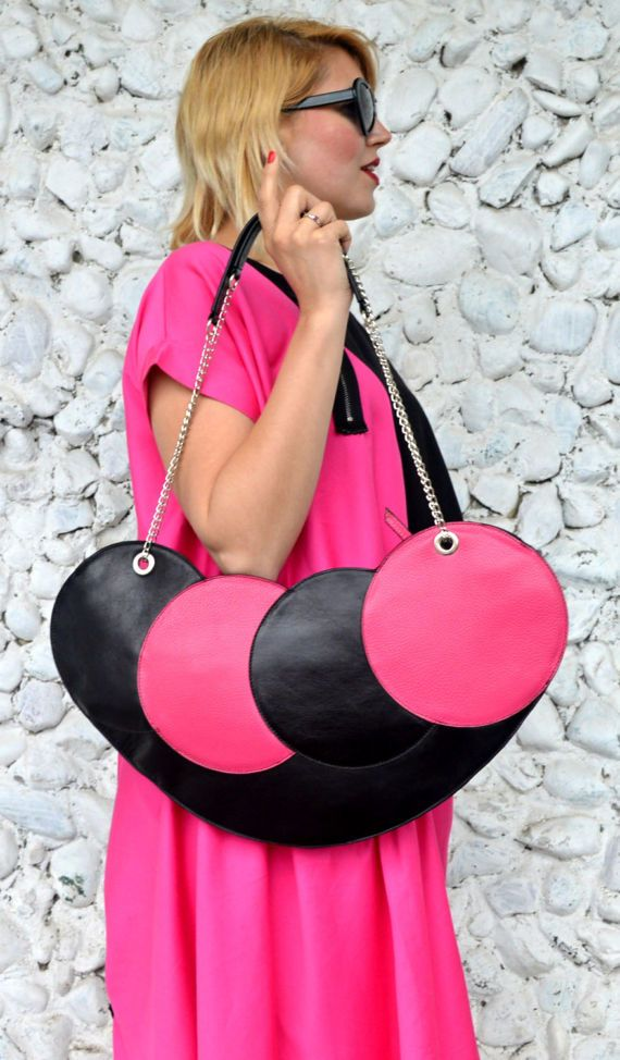 Extravagant black and fuchsia tote that will brighten up your wardrobe and jazz up the streets! Fun, artsy and playful design made of genuine leather, soft and light, easy an definitely fun to wear! Genuine leather tote from the new and daring The French Kiss collection. Dimensions: length 50 cm ( 19,68 inches), height 25 cm ( 9,84 inches). Handle length 75 cm ( 29,52 inches)  Material: 100% genuine leather