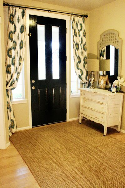 Curtains at the front door that can be closed at night to hide windows and glass front door