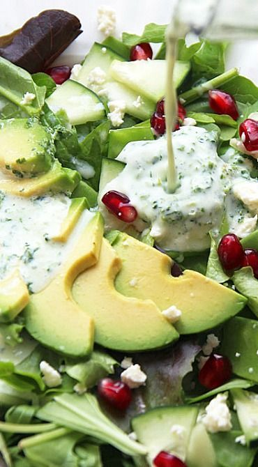 Green Goddess Winter Salad -this simple and healthy recipe includes delicious greens with avocado, pomegranate and feta drizzled with Green Goddess salad dressing.
