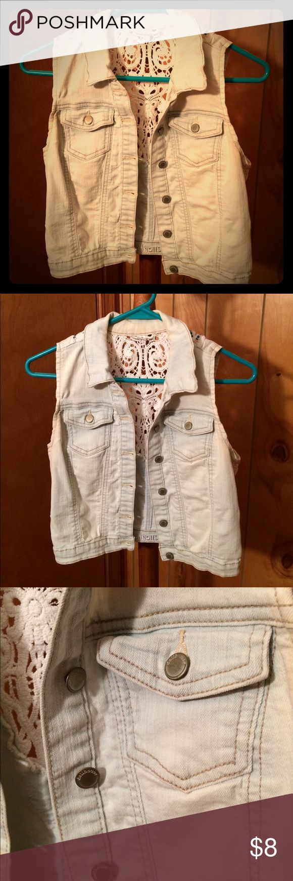 Jean jacket Sleeveless jean jacket. Light blue in color with crochet detailing in the back. Size medium. Dollhouse Tops
