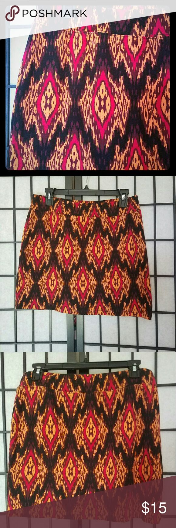 """Peices by Kensie Streach Tribal Print Skirt. Like new condition. I just could never jive with the colours in my wardrobe. It's super comfy and streachy.   The colours are burnt orange, black, and maroon, with a hint of purple. It's a real stunner. Waist 151/2"""", Length 151/2"""". Kensie Skirts Pencil"""