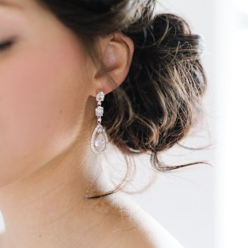Crystal Cubic Zirconia Bridal Earrings by Pearl & Ivory ®  - Find more inspiring wedding earrings and bridal jewelry from our collection www.pearlandivory.com/bridal-jewelry.html. Photography by Yolande Marx #PearlandIvory #CubicZirconia #Crystal #DropEarrings #Bridal #Earrings #WeddingJewelry