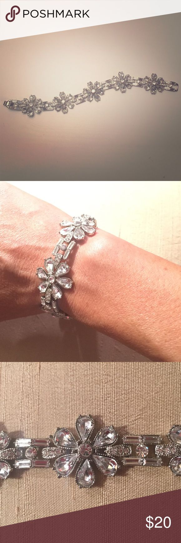 Elegant rhinestone flower link bracelet Elegant rhinestone flower link bracelet. Sparkles beautifully, perfect for a bride-to-be at her wedding celebration. Timeless and classy. Jewelry Bracelets