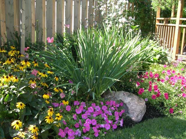 Flower bed with large rock