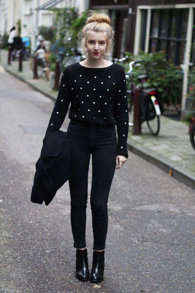 wearing all black is a timeless fashion idea. how cute and not boring this is with that gold studded sort of cropped sweater and a hair bun!