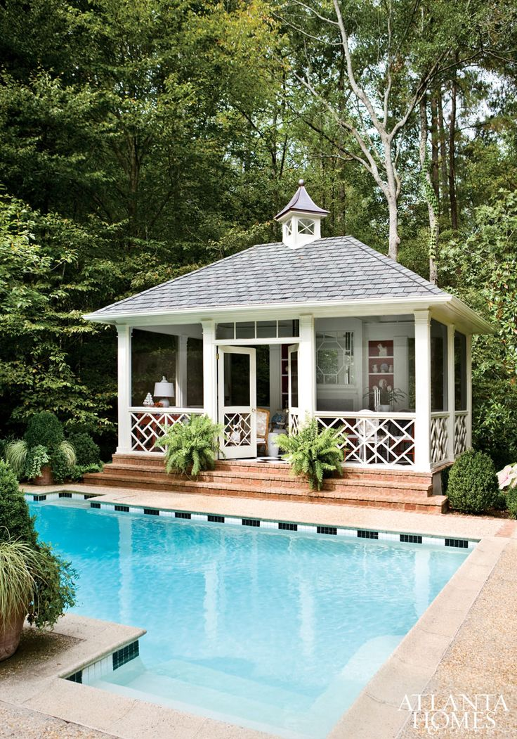 Beautiful pool house and love the black and white tile stripes