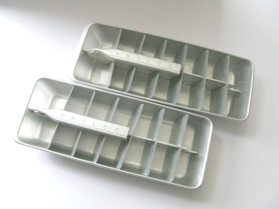 Set of Two (2) vintage Philco Metal Ice Cube Trays.  Makes 14 1 1/2 x 2 x 1 3/4 ice cubes (I tested these), the trays measure 11 long and 4 1/4 wide.