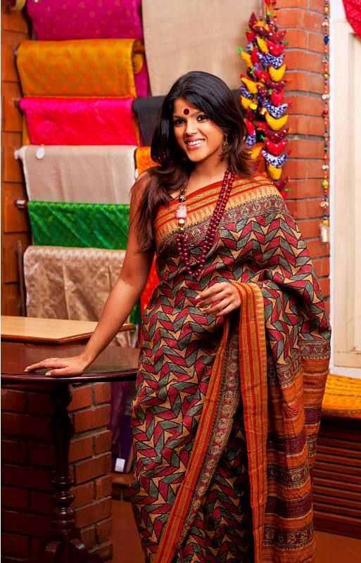 A printed sari paired with a big bindi is the ultimate Indian look for work.