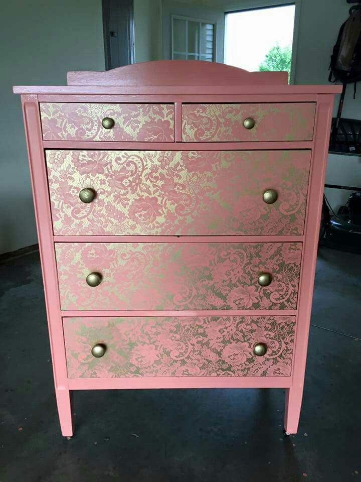 Lay lace over the front of the drawer and spray paint! Perfect and easy way to change up your furniture without buying new!